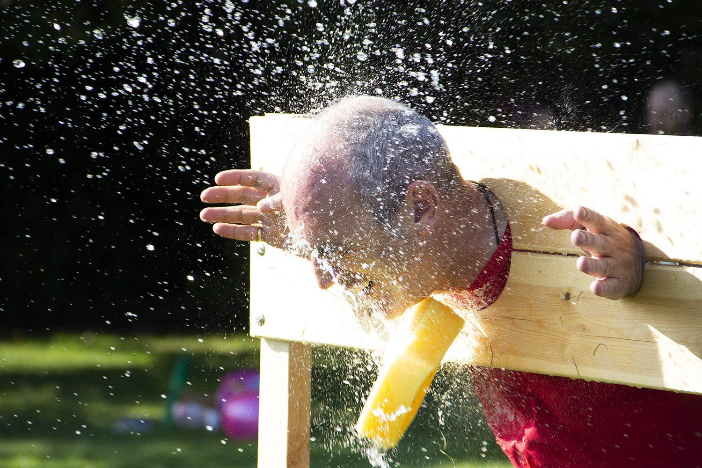 Sun, fun and a soaking for some at the Principals summer bash!